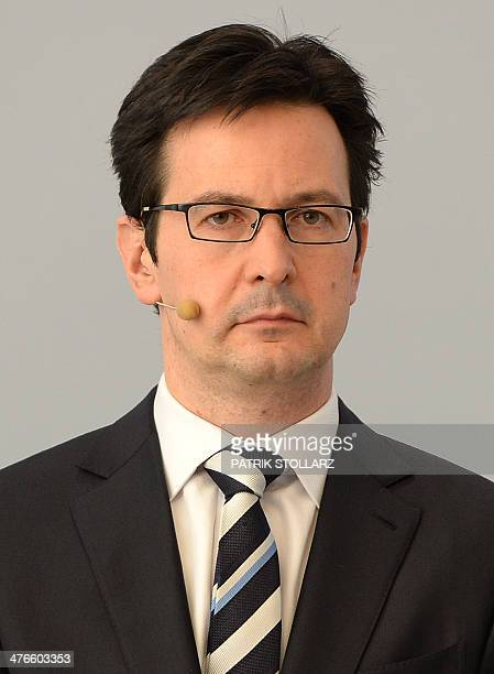 Bernhard Guenther member of the board of Germany's second biggestpower supplier RWE attends the annual press conference on March 4 2014 in Essen...