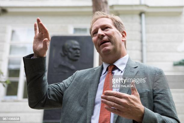 Bernhard Kuenburg president of the Semmelweis Foundation gestures during an interview in front of a commemorative plaque for pioneering scientist...