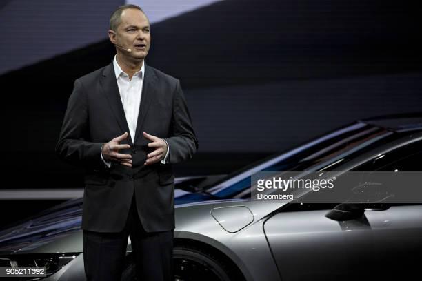 Bernhard Kuhnt president and chief executive officer BMW of North America LLC speaks while standing next to a Bayerische Motoren Werke AG i8 plugin...
