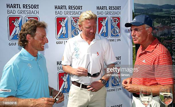 Bernhard Langer Boris Becker and Franz Beckenbauer chat together prior to the opening of Hartl Golf resort June 17 2007 in Penning Germany