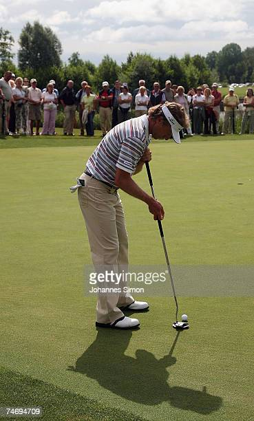 Bernhard Langer holes a putt during the Opening of Hartl Golf Resort on June 18 in Penning Germany