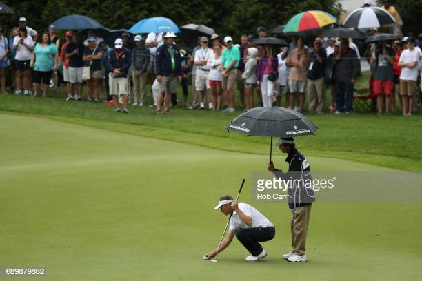 Bernhard Langer lines up a putt on the number one green during the final round of the Senior PGA Championship at Trump National Golf Club on May 28...