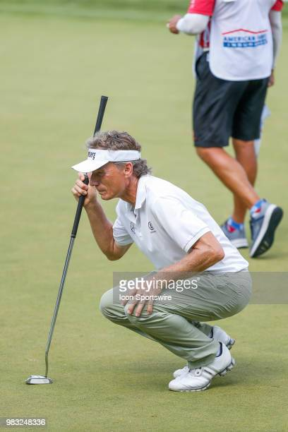 Bernhard Langer lines up his putt on eighteen during the final round of the American Family Insurance Championship Champions Tour golf tournament on...