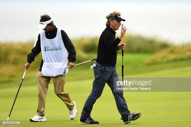 Bernhard Langer of Germany acknowledges the crowd on the 2nd green during the third round of the Senior Open Championship presented by Rolex at Royal...