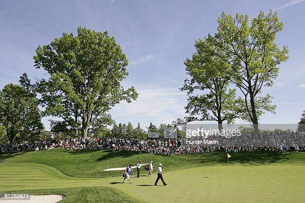 Bernhard Langer of Germany and Jeff Sluman walk onto the 13th green during the final round of the 69th Senior PGA Championship at Oak Hill Country...