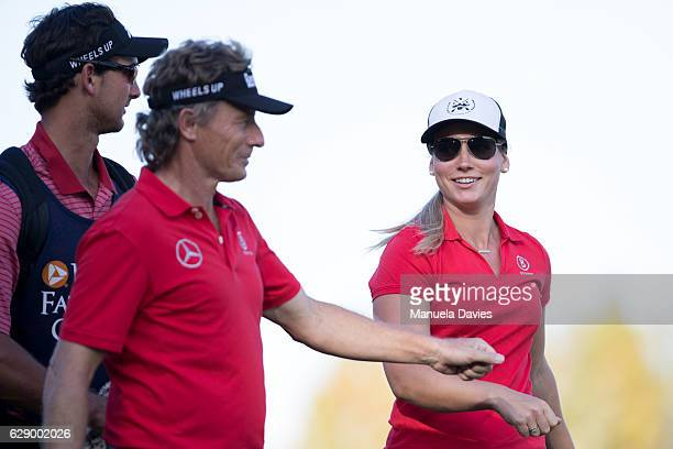 Bernhard Langer of Germany bumps fists with daughter Christina after her shot on the 18th fairway during the first round of the PNC Father/Son...
