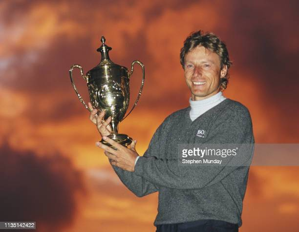 Bernhard Langer of Germany celebrates with the trophy after winning the Benson Hedges International Open on 11 May 1997 at The Oxfordshire Golf Club...