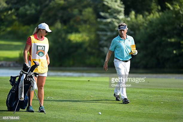 Bernhard Langer of Germany checks his yardage with caddie daughter Christina on the 15th hole during the final round of the Champions Tour Dick's...