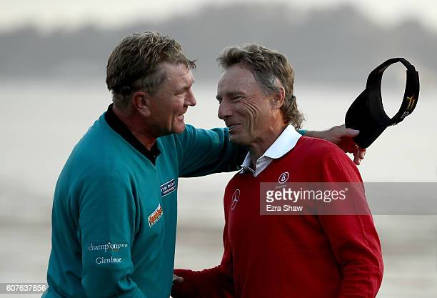 Bernhard Langer of Germany congratulates Paul Broadhurst of England after Broadhurst won the Nature Valley First Tee Open at Pebble Beach Golf Links...