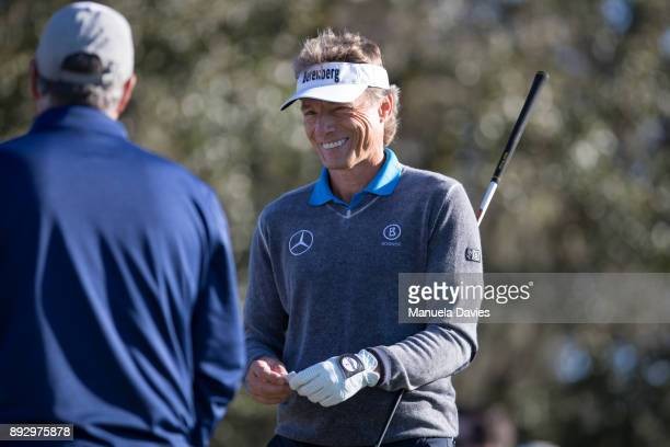Bernhard Langer of Germany gets ready to hit a tee shot on the 10th tee during the first round of the PNC Father/Son Challenge at The RitzCarlton...