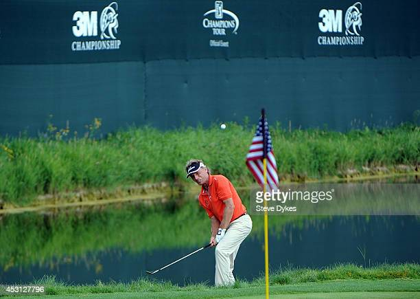 Bernhard Langer of Germany hits a chip shot from the edge of the 18th green during the final round of the 3M Championship at TPC Twin Cities on...