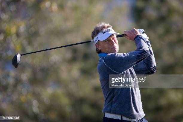 Bernhard Langer of Germany hits a tee shot on the 10th tee during the first round of the PNC Father/Son Challenge at The RitzCarlton Golf Club on...