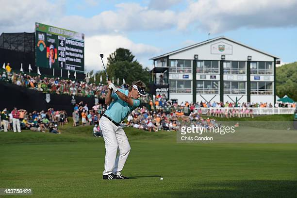 Bernhard Langer of Germany hits his approach on the 18th hole during the final round of the Champions Tour Dick's Sporting Goods Open at EnJoie Golf...