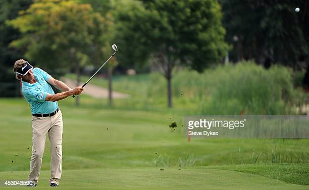 Bernhard Langer of Germany hits his approach shot on the sixth hole during the first round of the 3M Championship at TPC Twin Cities on August 1 2014...