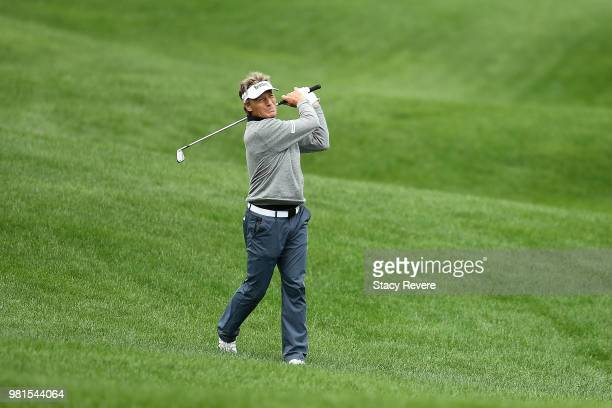 Bernhard Langer of Germany hits his second shot on the 18th hole during the first round of the American Family Insurance Championship at University...