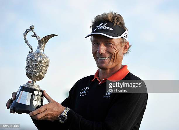 Bernhard Langer of Germany holds the Senior Open Championship trophy after his victory during the fourth round of the Senior Open Championship at...