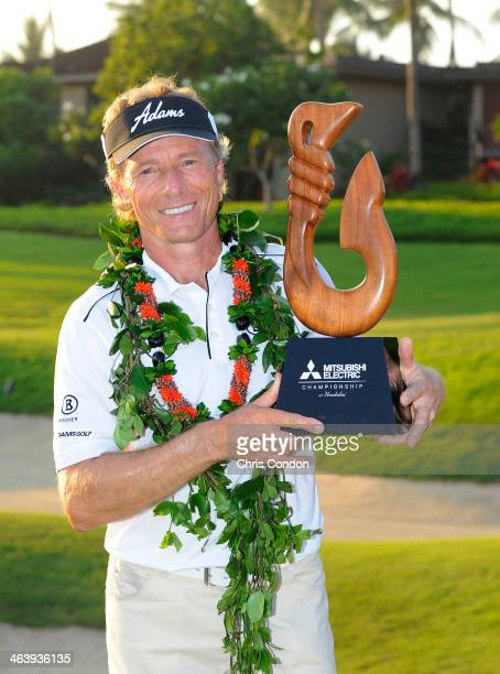 KA'UPULEHUKONA HI JANUARY 19 Bernhard Langer of Germany holds the tournament trophy after winning the Mitsubishi Electric Championship at Hualalai...