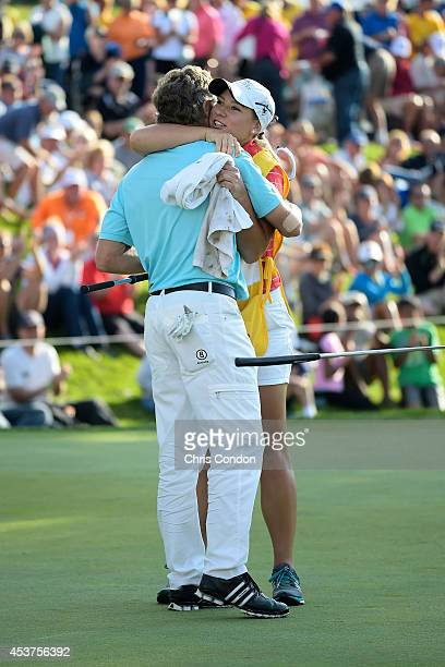 Bernhard Langer of Germany hugs his caddie daughter Christina Langer after winning the Champions Tour Dick's Sporting Goods Open at EnJoie Golf...