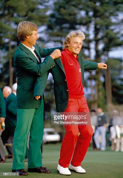Bernhard Langer of Germany is presented with the Green Jacket by last year's winner Ben Crenshaw of the United States after winning the US Masters...