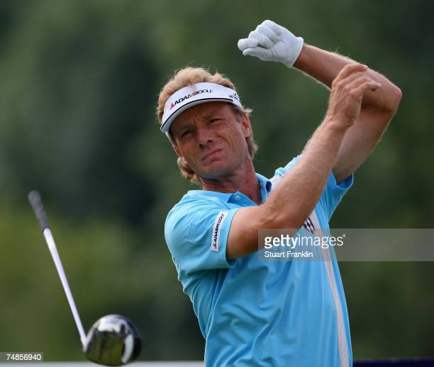 Bernhard Langer of Germany lets go of his club as he plays his tee shot on the 10th hole during the second round of The BMW International Open Golf...