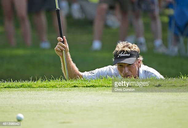 Bernhard Langer of Germany lines up a birdie putt on the 14th green during the third round of the Constellation SENIOR PLAYERS Championship at Fox...