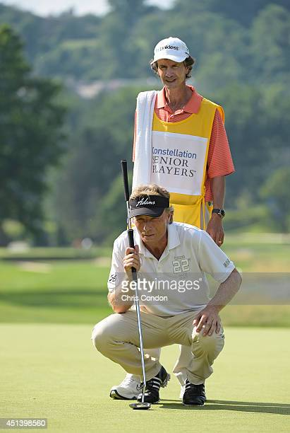 Bernhard Langer of Germany lines up a birdie putt on the 18th green during the third round of the Constellation SENIOR PLAYERS Championship at Fox...