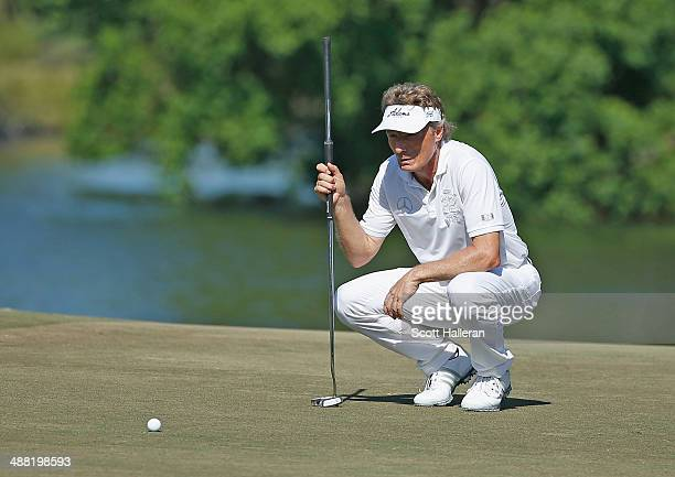 Bernhard Langer of Germany lines up a putt on the 17th green during the final round of the Insperity Invitational at the Tournament Course at the...