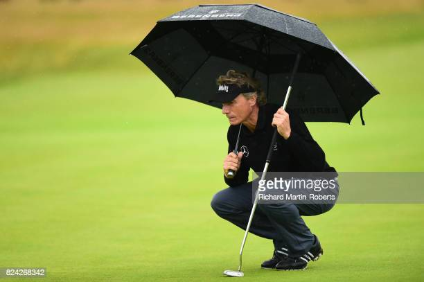 Bernhard Langer of Germany lines up a putt on the 18th green during the third round of the Senior Open Championship presented by Rolex at Royal...