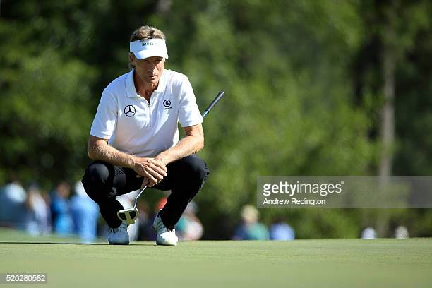 Bernhard Langer of Germany lines up a putt on the eighth green during the final round of the 2016 Masters Tournament at Augusta National Golf Club on...
