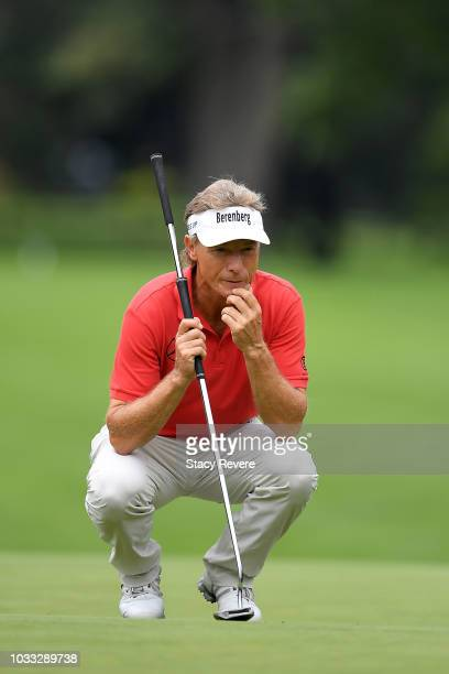 Bernhard Langer of Germany lines up a putt on the first green during the first round of the Ally Challenge presented by McLaren at Warwick Hills Golf...
