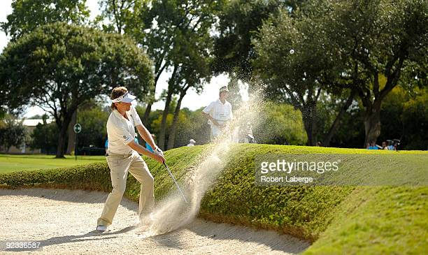 Bernhard Langer of Germany makes a shot out of a bunker on the 12th hole during the final round of the PGA Champions Tour AT&T Championship at the...
