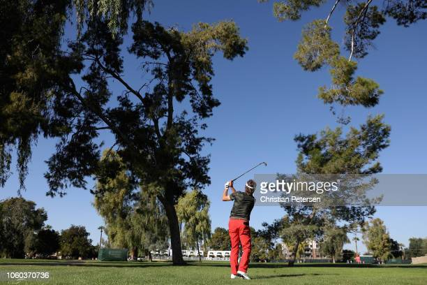 Bernhard Langer of Germany plays his second shot on the 17th hole during the final round of the Charles Schwab Cup Championship at Phoenix Country...