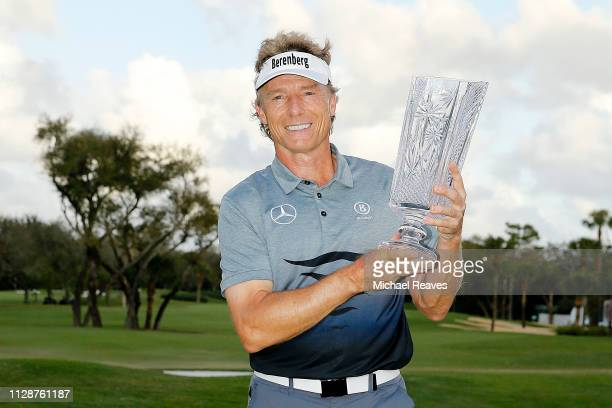 Bernhard Langer of Germany poses for a photo with the trophy after winning the Oasis Championship at The Old Course at Broken Sound on February 10...