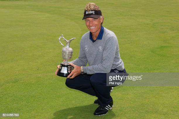 Bernhard Langer of Germany poses with the Senior Claret Jug after the final round of the Senior Open Championship at Royal Porthcawl Golf Club on...
