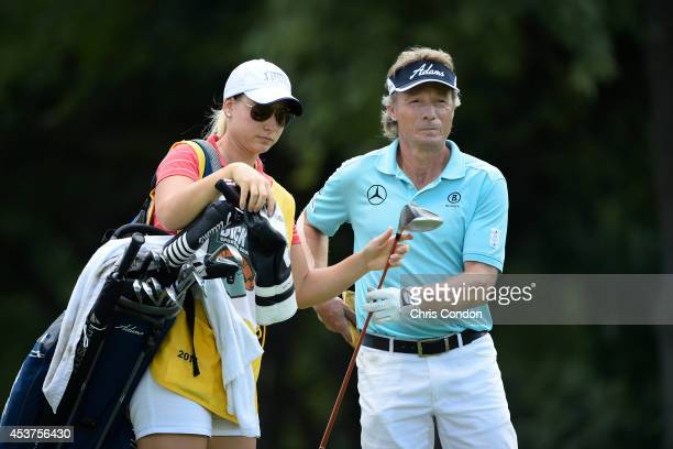 Bernhard Langer of Germany pulls a club with caddie daughter Christina on the second tee during the final round of the Champions Tour Dick's Sporting...