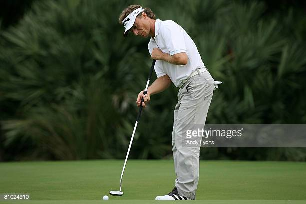 Bernhard Langer of Germany putts on the green of the 12th hole during the first round of THE PLAYERS Championship on THE PLAYERS Stadium Course at...