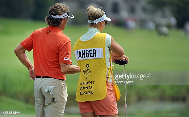 Bernhard Langer of Germany stands next to his daughter and caddie Christina Langer as they wait on the sixth hole during the final round of the 3M...