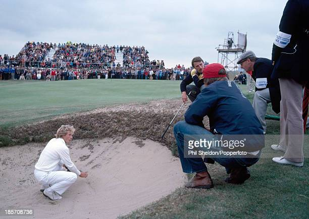 Bernhard Langer of Germany talking with his caddie and tournament officials during the British Open Golf Championship held at the Royal St George's...