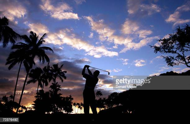 Bernhard Langer of Germany tees off the 11th hole during the first round of the Sony Open at the Waialae Country Club on January 13, 2005 in...
