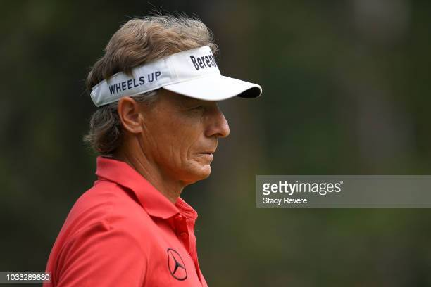 Bernhard Langer of Germany walks off the second tee during the first round of the Ally Challenge presented by McLaren at Warwick Hills Golf Country...