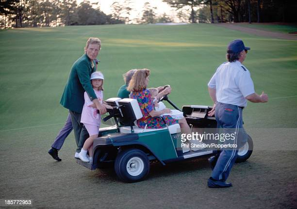 Bernhard Langer of Germany with his wife Vikki and their children Jackie Christina and Stefan being driven away on a golf buggy after Langer won the...