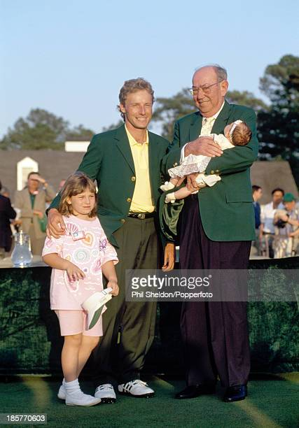 Bernhard Langer of Germany with Jack Stephens chairman of the Augusta National Golf Club and his daughters Jackie and Christina after winning the US...