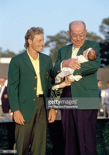 Bernhard Langer of Germany with Jack Stephens chairman of the Augusta National Golf Club holding Langer's daughter Christina after winning the US...