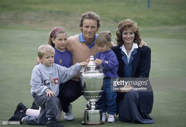 Bernhard Langer of West Germany with his wife Vikki and children Jackie Stefan and Christina and the trophy after winning the Volvo PGA Championship...