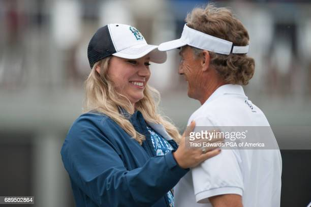 Bernhard Langer's daughter Christina Langer congratulates him on his win on the 18th green during Final Round for the 78th KitchenAid Senior PGA...