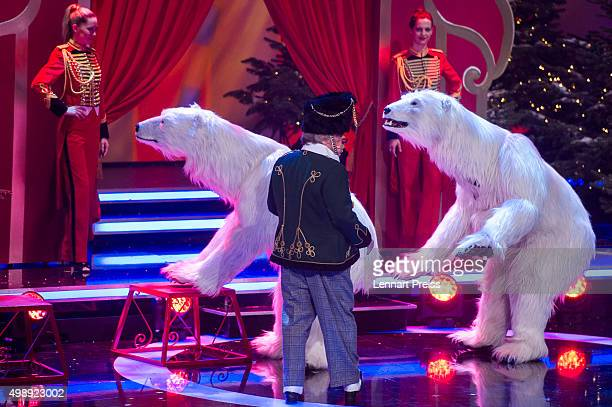 Bernhard Paul director of Circus Roncalli performs their polar bear show during the 'Heiligabend mit Carmen Nebel' TV show at Bavaria Filmstudios on...