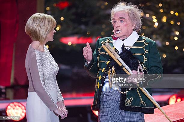 Bernhard Paul director of Circus Roncalli talks to Carmen Nebel during the 'Heiligabend mit Carmen Nebel' TV show at Bavaria Filmstudios on November...