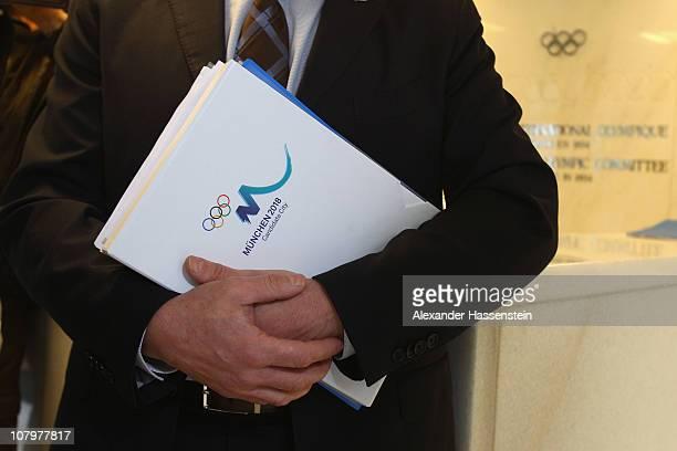 Bernhard Schwank, CEO of the Munich 2018 Bid Committee holds the Bid book prior to the Bid Book handover at the IOC headquarter on January 11, 2011...