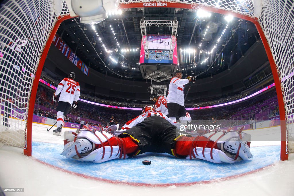 Bernhard Starkbaum #29 of Austria gives up a goal to Jeff Carter #77 of Canada in the second period during the Men's Ice Hockey Preliminary Round Group B game on day seven of the Sochi 2014 Winter Olympics at Bolshoy Ice Dome on February 14, 2014 in Sochi, Russia.