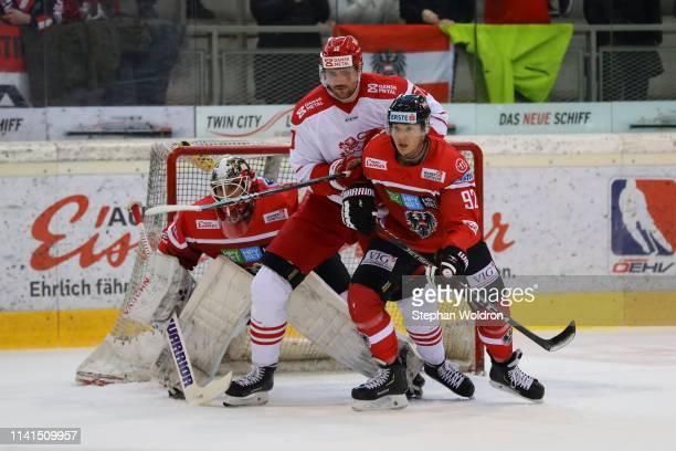 Bernhard Starkbaum of Austria, Mathias Bau Hansen of Denmark and Clemens Unterweger of Austria during the Austria v Denmark - Ice Hockey...